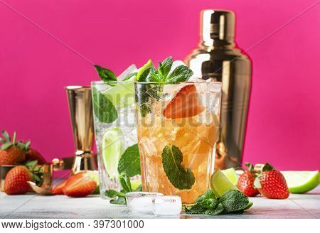 Fresh Mojito Cocktail Set With Lime, Mint, Strawberry And Ice In Glass On Pink Background. Summer Co