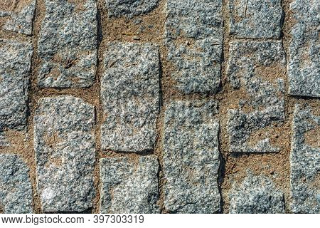 Fragment Of A Pavement Pavement For Use As An Abstract Background And Texture.