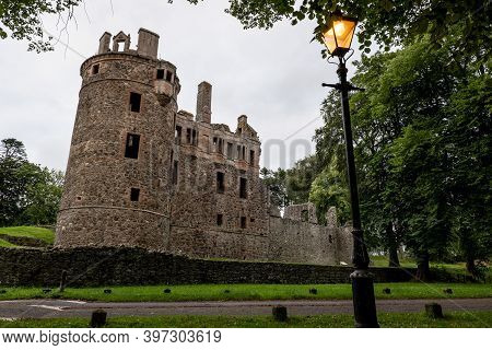 Legendary Huntly Castle In Scotland, Uk In Early Evening With Lamppost And The Light On