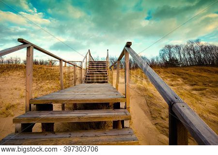 Wooden Staircase With A Handrail, Perspective View