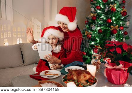 Merry Christmas, Happy Mother And Her Daughter Having Dinner At Home. Video Greetings To His Dad And