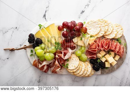 Charcuterie Board With Variety Of Cheese And Meats