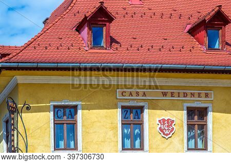 Sibiu, Transylvania, Romania - July 8, 2020: Roofs With Windows And Facade For Houses, Typical Archi