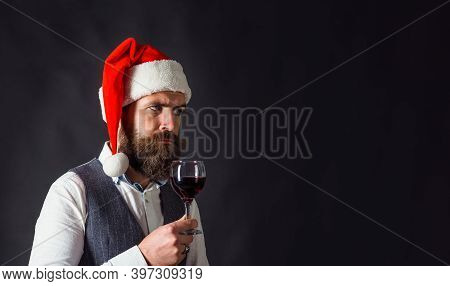 Santa With Glass Of Wine. Red Wine. Santa With Glass Of Wine. Man In Suit Drinks Wine. Alcohol. Man