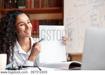 Smiling Female Manager Having Videocall On Laptop, Giving Virtual Presentation Or Online Lesson To S