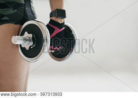 Perfect Strong Body And Exercise With Gadget. Adult Woman Athlete Or Trainer In Sportswear, Gloves A