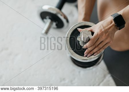Modern Technology And Strength Training. Middle Aged Woman With Fitness Tracker, Tunes Tools, Change