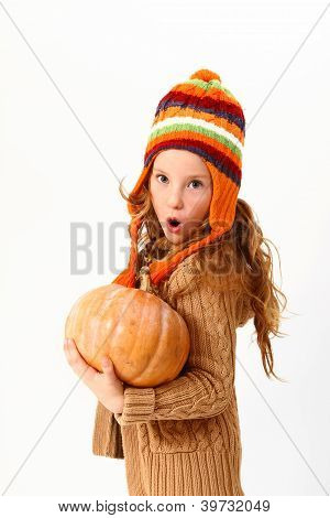 Surprised Little Girl With Pumpkin Isolated On White Background
