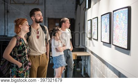 Group Of Friends In Modern Art Exhibition Gallery Hall