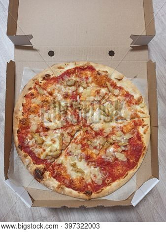Cut Slices Of Fresh Appetizing Pizza In Box. Piza Ready For Eating. Slices Of Fresh Appetizing Pizza