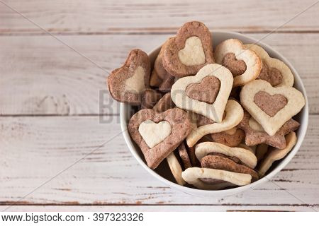 Shortbread Cookies Of Two Colors In A White Plate On A Wooden Background. Sweet Cookies In The Form