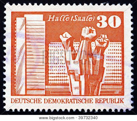 a stamp printed in GDR shows Worker's Memorial, Halle, circa 1973 poster