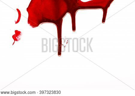 Drops Of Blood Running Down. Blood Flows Down The White Wall