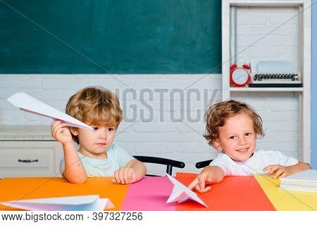 Children Pupills In Classroom Near Blackboard Desk. Kid At School. Teachers Day. Cheerful Smiling Ch