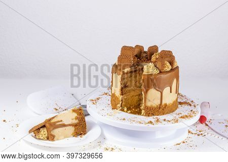 A Delicious Biscuit Cake, Pastry Cream, Chocolate Coating And Biscuit Earth Base On Plate And Pastry