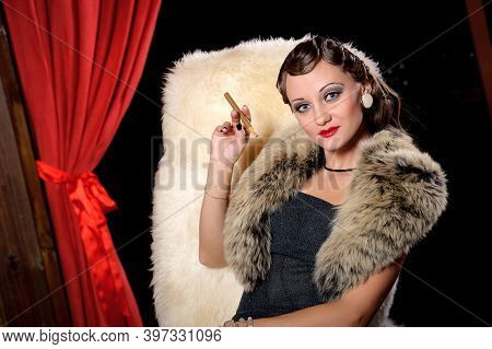 Retro Woman With A Mouthpiece. Smoking Lady. Old Fashioned Makeup And Wavy Hair. Hollywood Style Of