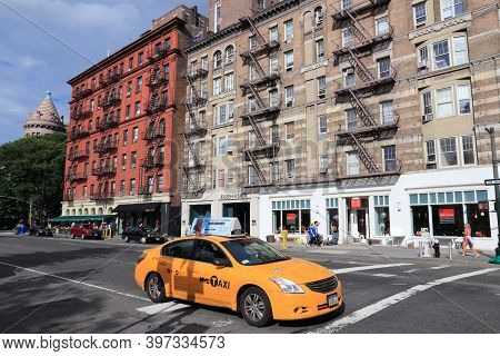 New York - July 2, 2013: People Ride Yellow Taxi In Lower Manhattan In New York. As Of 2012 There We