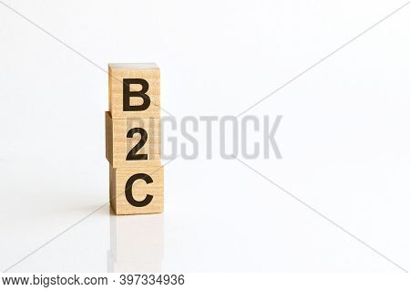 B2c - Acronym From Wooden Blocks With Letters, Business-to-consumer. White Background.