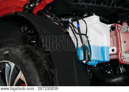 Tank With Washer Fluid And A Motor In The Car Body
