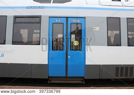 Modern Train Doors Gray And Blue Close Up