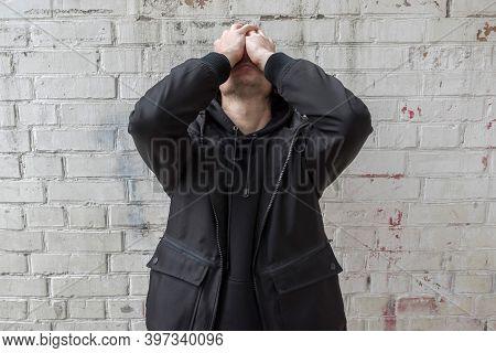 Addict Experiencing A Drug Addiction Crisis, Against A White Brick Wall. International Drug Abuse Da