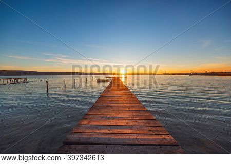 Sunset Over The Lake And Wooden Jetty, Hdr Image.