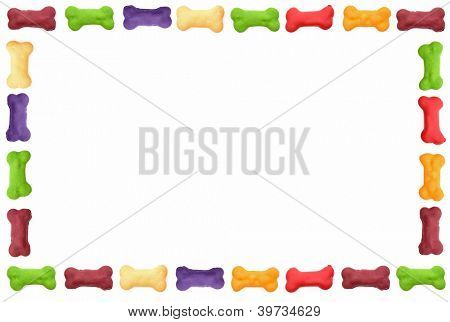 Colored dog biscuit frame isolated on white background.