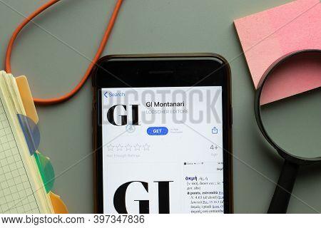 New York, Usa - 1 December 2020: Gi Montanari Mobile App Icon On Phone Screen Top View, Illustrative