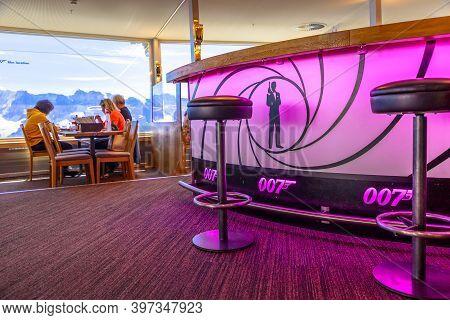 Schilthorn, Switzerland - Aug 19, 2020: Tourists Eat Inside Revolving Restaurant Piz Gloria With 360