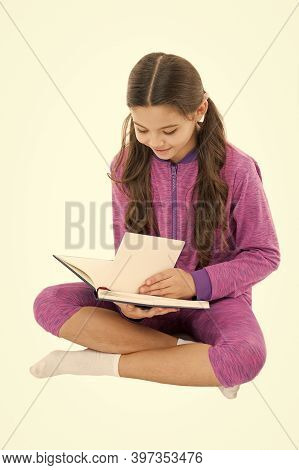 Reading Feeds Imagination. Small Child Read Book Isolated On White. Little Girl Enjoy Reading. Schoo