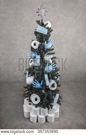 Holiday Christmas tree decorated with toilet paper, rubber gloves and face masks in honor of the medical community