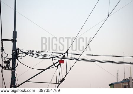 Catenary Power Overhead Line Of A Railroad Track, Supplying Electricity For Trains, With A Pylon Pil