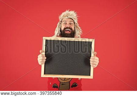 Marketing And Advertising. Happy Hipster Hold Empty Blackboard. Bearded Hipster In Winter Wear. Hips
