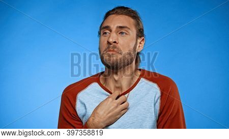 Young Man Feeling Unpleasant Smell On Blue