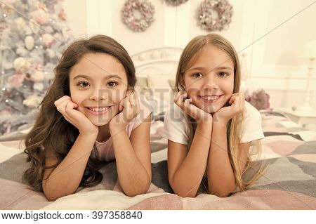 Happiness Lives Here. Happy Children Smile On Bed. Small Girls Enjoy Happiness On Xmas Eve. Childhoo