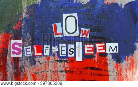 Cut Out Of Letters Magazines Compiled The Word Low Self-esteem On An Abstract Colorful Background