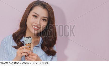 Beautiful Female Holding And Eating Ice Cream On Summer Holidays