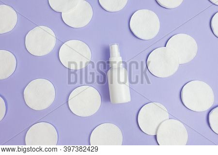 Top View And Close-up Of White Plastic Spray Bottle Mock-up And Cotton Pads Pattern On Purple Backgr