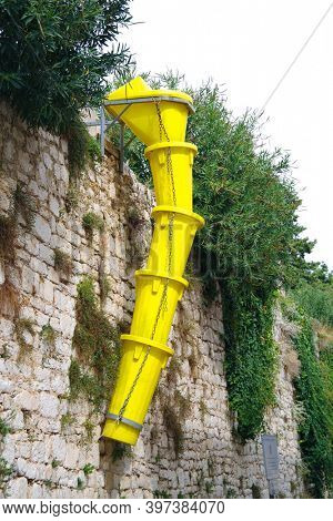 Yellow discharge chute for construction debris