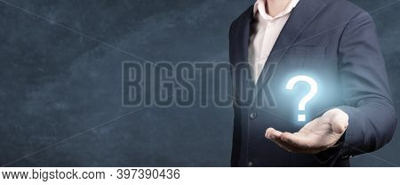 Businessman Holding Hand Question Marks In His Hand. Businessman Showing Question Mark. Man Holds A