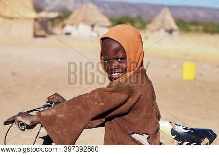 Opuwo, Namibia - Jul 07, 2019: Young Unidentified Himba Infant In A Himba Tribe Village