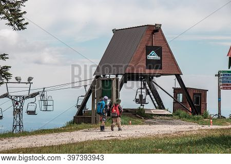 North Vancouver, Canada - July 6,2020: Two Little Boys Walking Near  The Older Double Chairlifts At