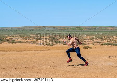 Russia, Baskunchak, May 25, 2019: Athlete Running Sport - Fitness Runner Sprinting In Desert Shirtle