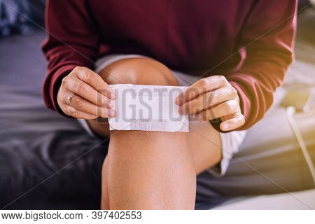 Woman Using White Patch For Relieve Wound On Knee,elastic Bandaged,gauze Pad