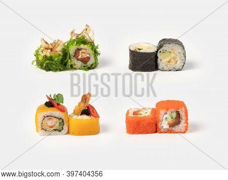 Sushi Maki Rolls. A Set Of Sushi Rolls With Salmon, Shrimp, Tuna Shavings, Chuka Salad, Tobiko Flyin
