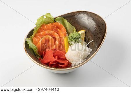Sushi Sashimi. Salmon Slices With Red Caviar, Radish Daikon Ibir, Wasabi, Lettuce And Lemon Wedge On