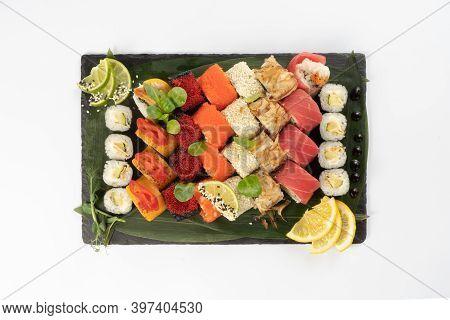 Large Assortment Of Assorted Sushi Maki Made From Salmon, Tuna, Shrimp Roe Of Tobiko Flying Fish, Ri