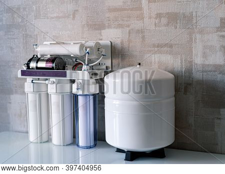 Household Filtration System. Water Treatment Concept. Use Of Water Filters At Home. Glass Of Clean W