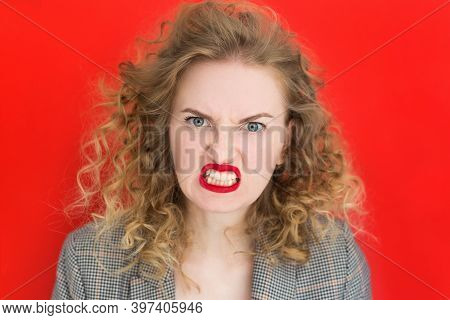Screaming, Hate, Rage. Emotional Angry Woman Is Angry On Red Studio Background. Emotional, Young Fac