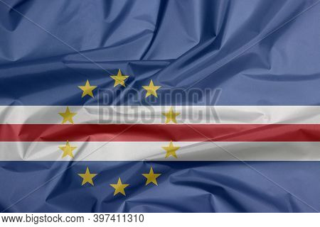 Fabric Flag Of Cape Verde. Crease Of Cape Verde Flag Background, Blue White And Red Color With The C